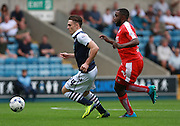 Millwall player Ben Thompson gets the better of Chesterfield player Sylvan Ebanks-Blake during the Sky Bet League 1 match between Millwall and Chesterfield at The Den, London, England on 29 August 2015. Photo by Bennett Dean.