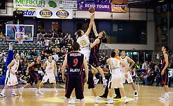 Gasper Vidmar (13) of Olimpija vs Tiago Splitter of Caja Laboral Baskonia at Group C of Euroleague basketball match between KK Union Olimpija, Slovenia and Caja Laboral, Spain, on November 5, 2009, in Arena Tivoli, Ljubljana, Slovenia.  (Photo by Vid Ponikvar / Sportida)