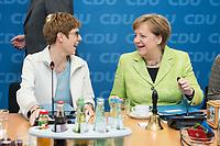 27 MAR 2016, BERLIN/GERMANY:<br /> Annegret Kamp-Karrenbauer (L), CDU, Ministerpraesidentin, und Angela Merkel (R), CDU, Budneskanzlerin, im Gespraech, vor Beginn einer Sitzung des Bundesvorstandes nach der Landtagswahl im Saarland, Konrad-Adenauer-aus<br /> IMAGE: 20170327-01-012<br /> KEYWORDS: Gespr&auml;ch