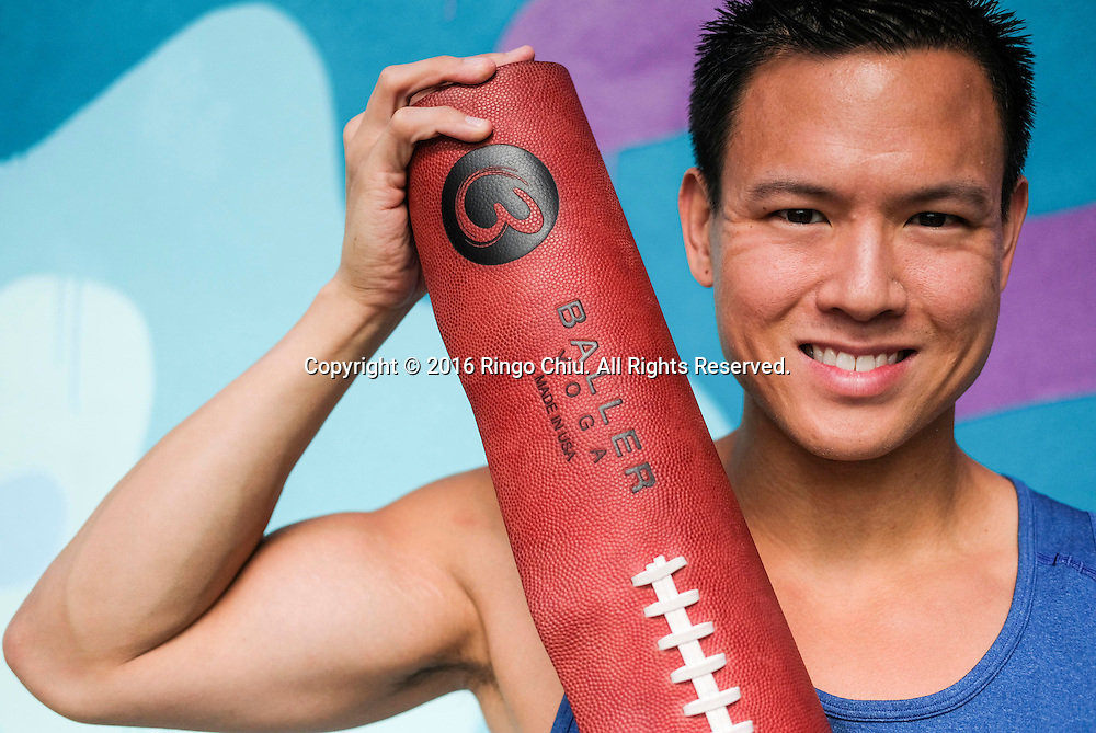 Cedric Yau, founder of Baller Yoga, with his new yoga mats.<br /> (Photo by Ringo Chiu/PHOTOFORMULA.com)<br /> <br /> Usage Notes: This content is intended for editorial use only. For other uses, additional clearances may be required.