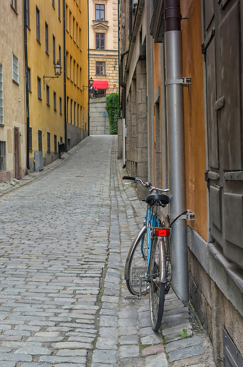 A blue bicycle on a quaint cobblestone street in Gamla Stan, Old Town, Stockholm, Sweden, Europe.