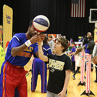 Libby Ezell | BUY AT PHOTOS.DJOURNAL.COM<br /> Dragon from the Globetrotters shows Brodie Cole, 10, how to spin a basketball on his finger