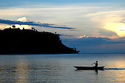 Ruarwe, Lake Malawi, Malawi, Southern East Africa..Siloutte of a fisherman coming in to the village of Ruarwe from a day of work on Lake Malawi...© Demelza Cloke.DVD0001