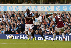 West Ham United's Guy Demel and Tottenham Hotspur's Jermain Defoe compete for the ball - Photo mandatory by-line: Mitchell Gunn/JMP - Tel: Mobile: 07966 386802 06/10/2013 - SPORT - FOOTBALL - White Hart Lane - London - Tottenham Hotspur V West Ham United - Barclays Premiership