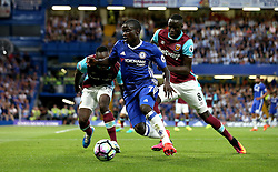 Ngolo Kante of Chelsea runs with the ball away from Michail Antonio and Cheikhou Kouyate of West Ham United - Mandatory by-line: Robbie Stephenson/JMP - 15/08/2016 - FOOTBALL - Stamford Bridge - London, England - Chelsea v West Ham United - Premier League