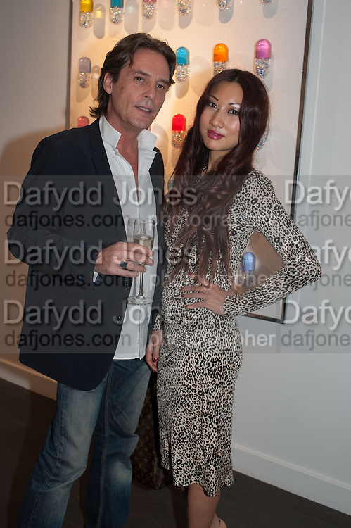 MARCEL JEAN VAS; AMY YAU, Vogue's Fashion night out special opening of the Halcyon Gallery.  New Bond St. London. 6 December 2012.