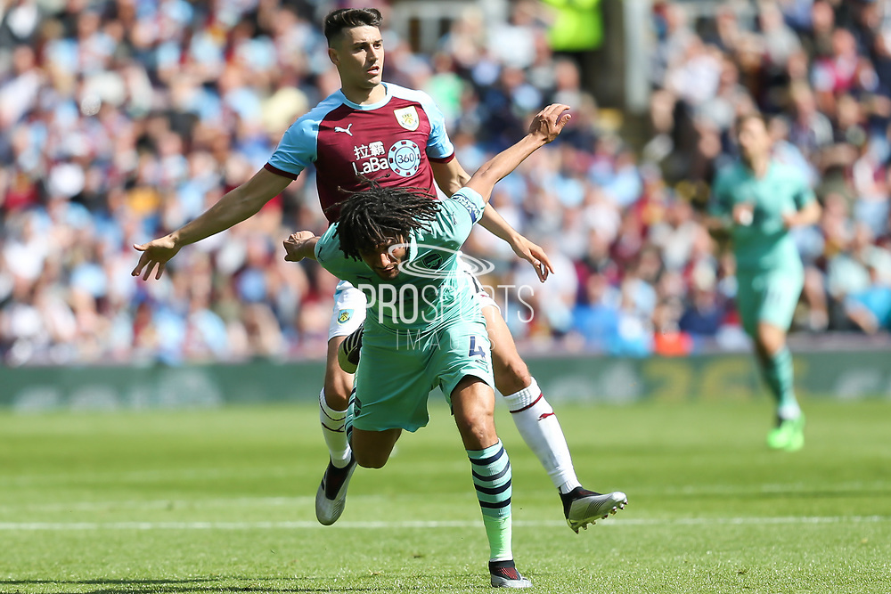 Burnley defender Matthew Lowton (2) and Arsenal midfielder Mohamed Elneny (4) have a coming together during the Premier League match between Burnley and Arsenal at Turf Moor, Burnley, England on 12 May 2019.