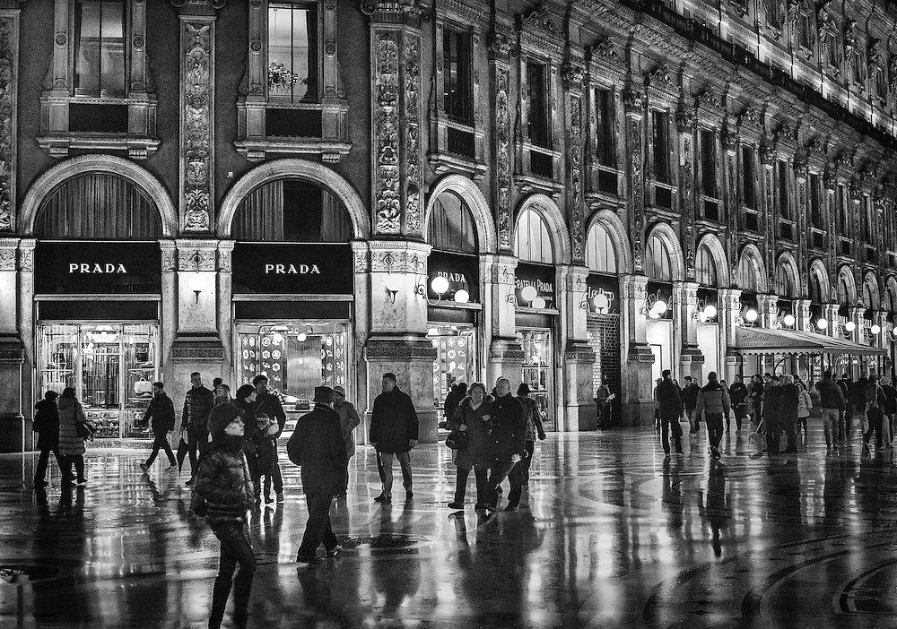 Evening shoppers and strollers in the historic Galleria Vittorio Emanuele II in Milan, Italy. March, 2013.