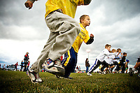 JEROME A. POLLOS/Press..Tristan Miller, from Ramsey Elementary, takes off from the starting line alongside other first grade students Tuesday during the district wide elementary cross country meet held at Lake City High School. About 700 runners were expected to compete in the event.