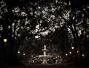 Lined by century old live oak trees, dripping in spanish moss, the fountain at Forsyth Park stands near the middle of historic district's largest park. (Photo by Stephen Morton).