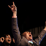 A man screams and celebrates with arms raised on U street in Washington DC after Barack Obama was announced the winner of the 2012 presidential elections.