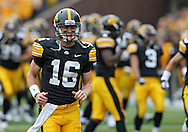 September 17, 2011: Iowa Hawkeyes quarterback James Vandenberg (16) runs onto the field before the start of the game between the Iowa Hawkeyes and the Pittsburgh Panthers at Kinnick Stadium in Iowa City, Iowa on Saturday, September 17, 2011. Iowa defeated Pittsburgh 31-27.