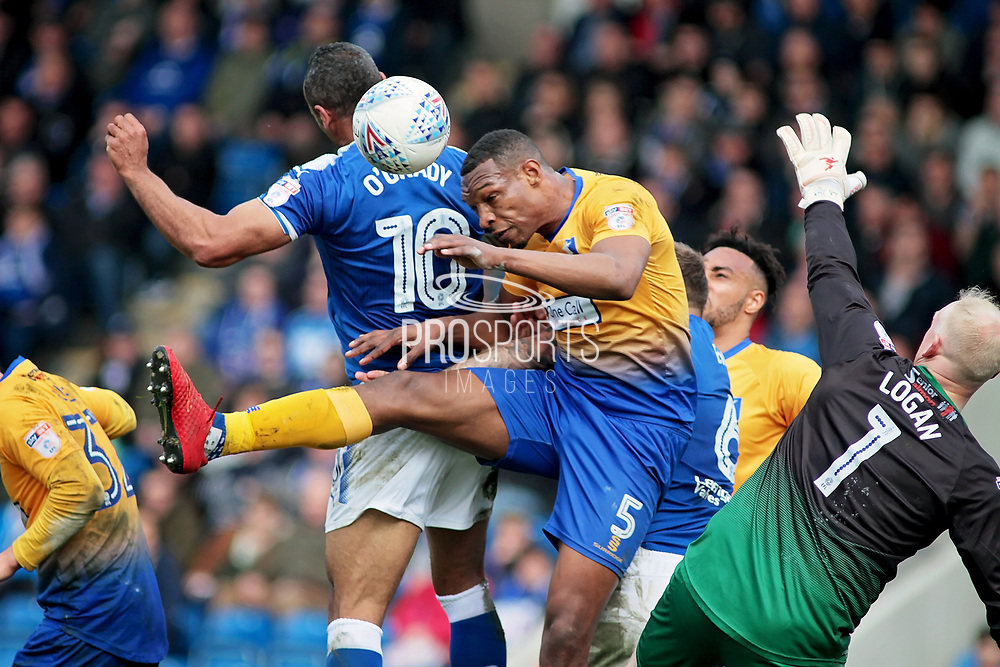 Mansfield Town defender Krystian Pearce (5) clears from Chesterfield forward Chris O'Grady (10) during the EFL Sky Bet League 2 match between Chesterfield and Mansfield Town at the Proact stadium, Chesterfield, England on 14 A pril 2018. Picture by Nigel Cole.