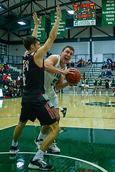 BLOOMINGTON, IL - November 12: Charlie Bair works in against Christian Wagner during a college basketball game between the IWU Titans  and the Blackburn Beavers on November 12 2019 at Shirk Center in Bloomington, IL. (Photo by Alan Look)