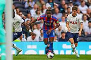 Crystal Palace forward Wilfried Zaha (11) runs towards the goal during the Premier League match between Tottenham Hotspur and Crystal Palace at Tottenham Hotspur Stadium, London, United Kingdom on 14 September 2019.