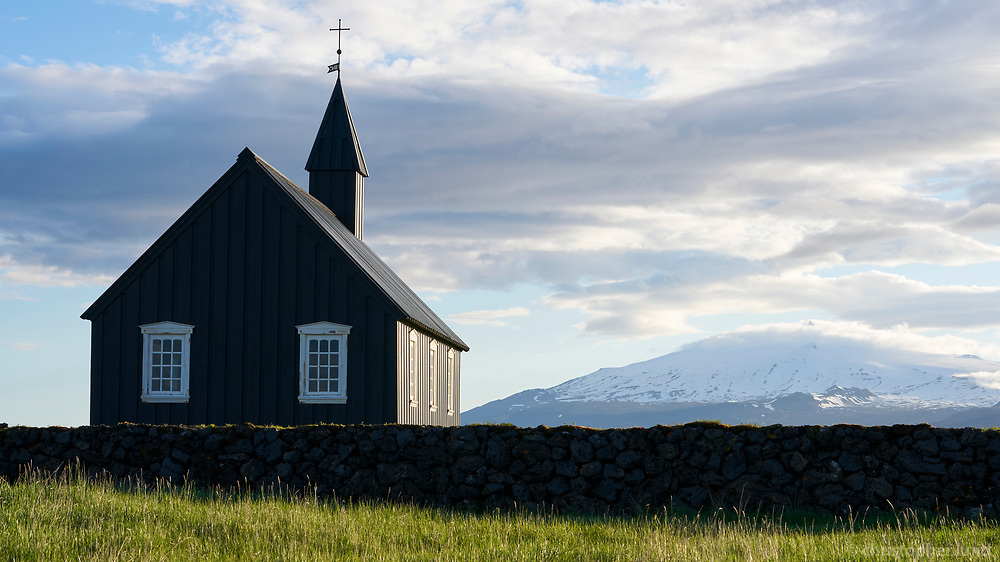 The black church at Búðir. Snæfellsjökull glacier in background. Snæfellsnes Peninsula, West Iceland.