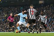 Ciaran Clark stopping Sergio Aguero during the Premier League match between Manchester City and Newcastle United at the Etihad Stadium, Manchester, England on 20 January 2018. Photo by George Franks.