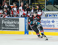 KELOWNA, CANADA, DECEMBER 3: Colten Martin #8 of the Kelowna Rockets skates with the puck as the Prince George Cougars visit the Kelowna Rockets  on December 3, 2011 at Prospera Place in Kelowna, British Columbia, Canada (Photo by Marissa Baecker/Shoot the Breeze) *** Local Caption ***
