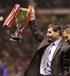 Manchester, England - Tuesday, March 13, 2007:  Former Manchester United's player Denis Irwin lifts up the European Cup Winners' Cup, which he won in 1991, before the UEFA Celebration Match between Manchester United and Europe XI at Old Trafford. (Pic by David Rawcliffe/Propaganda)