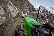 Jaibir Singh Virk driving the tractor on the Srinagar Leh Highway at Zoji La Pass, Kashmir...In May 2012, Fox Adventure Club set a record for the Longest Tractor Expedition, when three members covered 3623 kms across the western Himalayas in just 14 days on a 65hp Farm Tractor.