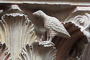 Carved polychrome Romanesque capital, 12th century, with dove representing Christians, pecking an owl, a night bird, representing heathens, and acanthus leaves, in the nave of the Cathedrale Saint-Julien du Mans or Cathedral of St Julian of Le Mans, Le Mans, Sarthe, Loire, France. The cathedral was built from the 6th to the 14th centuries, with both Romanesque and High Gothic elements. It is dedicated to St Julian of Le Mans, the city's first bishop, who established Christianity in the area in the 4th century AD. Picture by Manuel Cohen