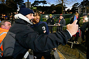 Nathan Ake (5) of AFC Bournemouth has a selfiw with a fan as he arrives at the Vitality Stadium before the Premier League match between Bournemouth and Chelsea at the Vitality Stadium, Bournemouth, England on 30 January 2019.