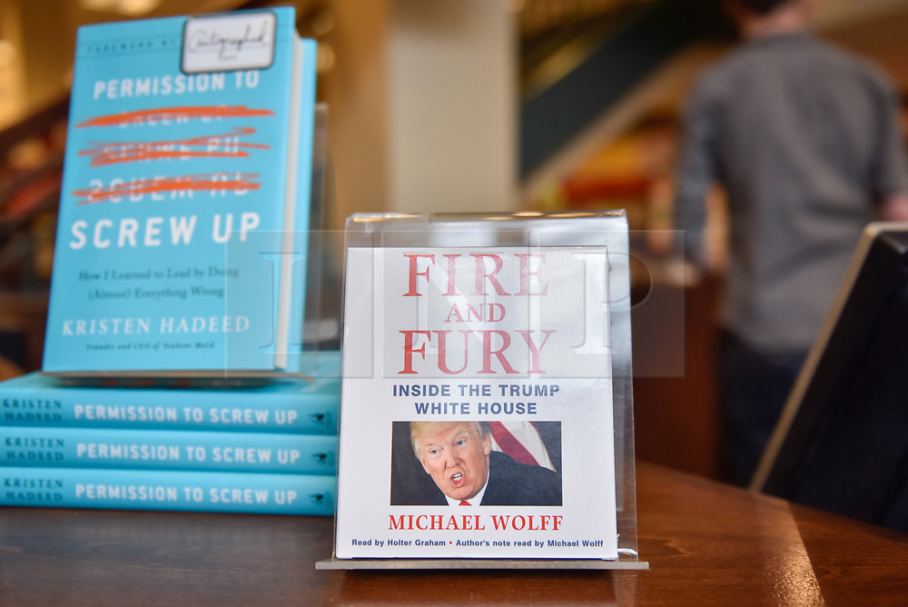 """© Licensed to London News Pictures. 07/01/2018. CHICAGO, USA.  An audiobook of the new book """"Fire and Fury, Inside the Trump White House"""", by Michael Wolff is on display in Barnes & Noble bookshop in downtown Chicago.  Barnes & Noble have already received advanced orders ahead of the official on sale date of 9 January, but some other booksellers have obtained advance copies which have sold immediately sold out.   Photo credit: Stephen Chung/LNP"""
