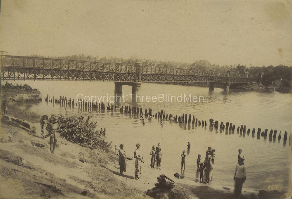 Matara Bridge. Bathing place enclosed against crocodilse.<br /> by Skeen &amp; Co.
