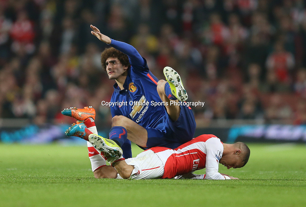 22 November 2014 - Barclays Premier League - Arsenal v Manchester United - Marouane Fellaini of Manchester United tangles with Kieran Gibbs of Arsenal - Photo: Marc Atkins / Offside.