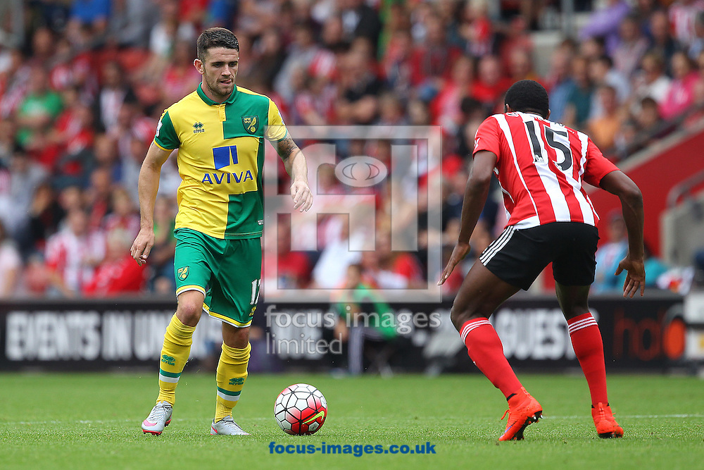 Robbie Brady of Norwich and Cuco Martina of Southampton in action during the Barclays Premier League match at the St Mary's Stadium, Southampton<br /> Picture by Paul Chesterton/Focus Images Ltd +44 7904 640267<br /> 30/08/2015