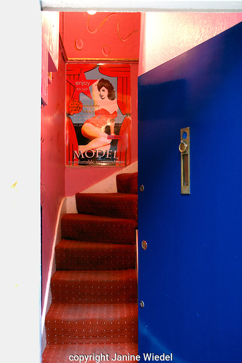 Stairs leading up to prostitutes room in Shepherd's market behind Park Lane London.