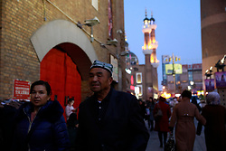 Ethnic Uighur minority people are seen in Dabazha or Grand Bazaar in Urumqi city, Xinjiang Uighur Autonomous Province, China, 18 November 2017. Uighurs, a Muslim ethnic minority group in China, make up about 40 per cent of the 21.8 million people in Xinjiang, a vast, ethnically divided region that borders Pakistan, Afghanistan, Kazakhstan, Kyrgyzstan and Mongolia. Other ethnic minorities living in here include the Han Chinese, Kyrgyz, Mongolian and Tajiks people. Xinjiang has long been subjected to separatists unrests and violent terrorist attacks blamed by authorities on Islamist extremism while human rights groups say Chinese repression on religious rights, culture and freedom of movement caused undue tensions. Life however goes on under the watchful eye of the government for the ethnic Uighurs living in the city of Urumqi and surrounding areas and the region is still considered an attractive tourist spot. A recent report by state media Xinhua news agency claims Xinjiang received more than 100 million tourists in 2017, 'the highest figure in its history'.