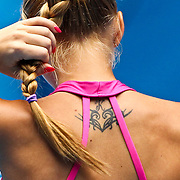 Alona Bondarenko of the Ukraine adjusts her ponytali during her third round victory over Jelena Jankovic of Serbia at the Australian Open Tennis Tournament in Melbourne, Australia, 22 January 2010.
