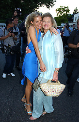 SIENNA MILLER and her mother at Sir David & Lady Carina Frost's annual summer party held in Carlyle Square, London on 6th July 2004.