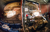Walls start to come down in the balcony area of the Colonial Theater as restoration work begins.  (Karen Bobotas/for the Laconia Daily Sun)