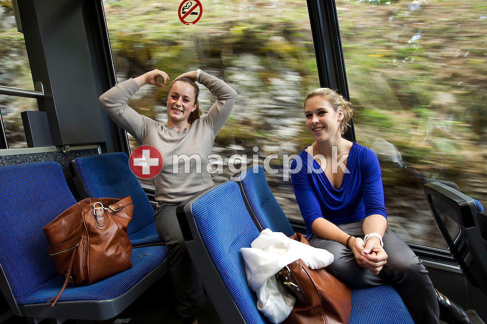Artistic gymnastics athlete Giulia STEINGRUBER (R) and her teammate Yasmin ZIMMERMANN of Switzerland are pictured during their ride withe a cable car of the 'Seilbahn-Funiculair Magglingen Macolin' in Biel, Switzerland, Monday, Aug. 29, 2011. (Photo by Patrick B. Kraemer / MAGICPBK)