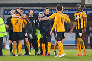 Cambridge United Ryan Donaldson is congratuled by team mate Cambridge United Michael Nelson during the The FA Cup match between Cambridge United and Manchester United at the R Costings Abbey Stadium, Cambridge, England on 23 January 2015. Photo by Phil Duncan.