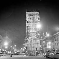 Scaffolding surrounds the remaining structure of Nelson's Pillar after the explosion that mostly destroyed it on March 8, 1966. Six days later the remaining structure was demolished by another explosion detonated by the army. (Part of the Independent Newspapers/NLI Collection)