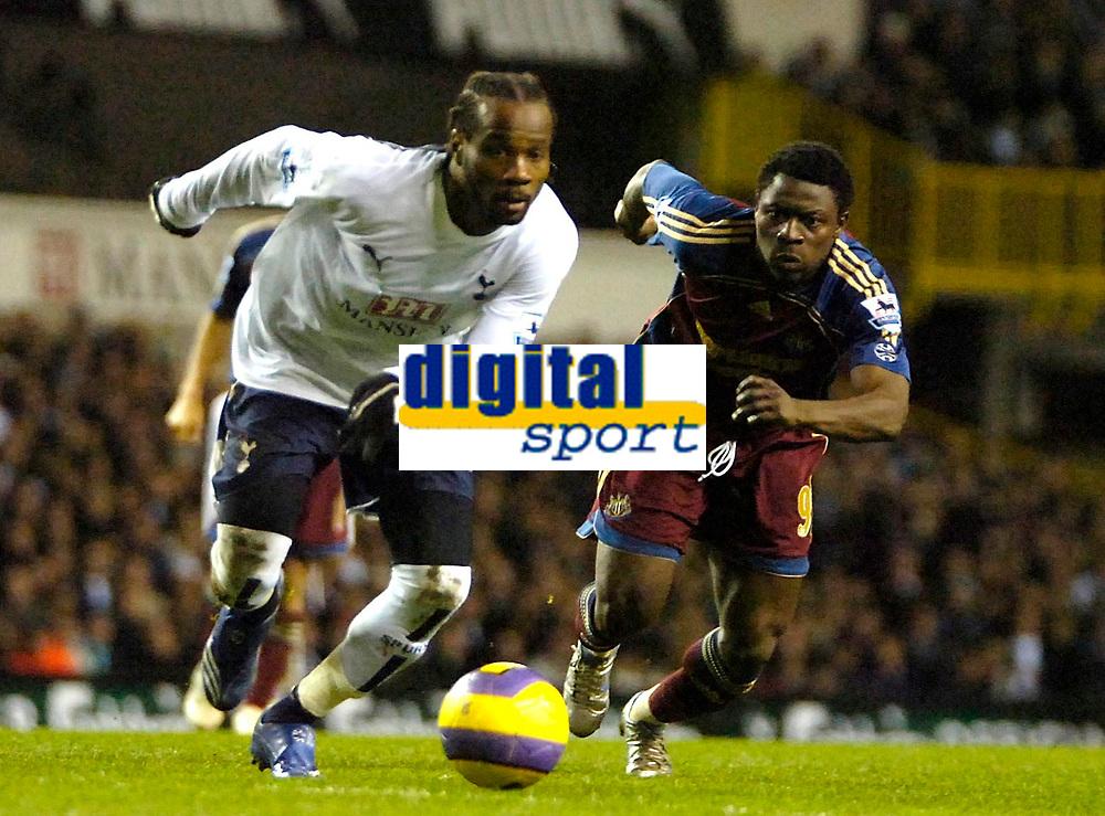 Photo: Ed Godden/Sportsbeat Images.<br /> Tottenham Hotspur v Newcastle United. The Barclays Premiership. 14/01/2007. Spurs' Pascal Chimbonda (L), advances past Obafemi Martins.