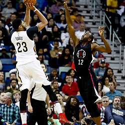 Dec 28, 2016; New Orleans, LA, USA;  New Orleans Pelicans forward Anthony Davis (23) shoots over Los Angeles Clippers forward Luc Mbah a Moute (12) during the first quarter of a game at the Smoothie King Center. Mandatory Credit: Derick E. Hingle-USA TODAY Sports