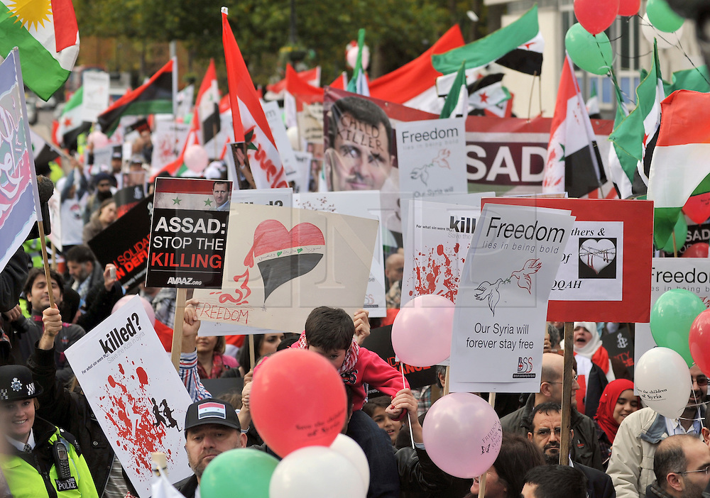 """35559258© Licensed to London News Pictures. 29/10/2011. London, UK.  Amnesty International join Syrians in the UK for a """"N0 More Blood - No More Fear"""" march and rally in Paddington Green, London, today 29th October 2011. Activists claim  Syrian security forces opened fire on Friday on protesters and hunted them down in house-to-house raids, killing about 40 people in the deadliest day in weeks in the country's 7-month-old uprising. Photo: Stephen Simpson/LNP"""