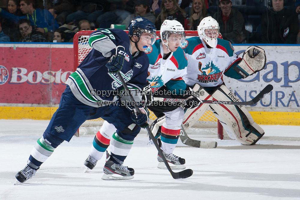 KELOWNA, CANADA - JANUARY 24: Cole Martin #8 and Jordon Cooke #30 of the Kelowna Rockets defend the net against Roberts Lipsbergs #29 of the  Seattle Thunderbirds at the Kelowna Rockets on January 24, 2013 at Prospera Place in Kelowna, British Columbia, Canada (Photo by Marissa Baecker/Shoot the Breeze) *** Local Caption ***