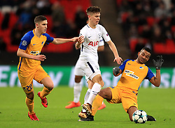 Tottenham Hotspur's Juan Foyth (centre) battles for the ball with Apoel Nicosia's Roland Sallai (left) and Lorenzo Ebecilio during the UEFA Champions League, Group H match at Wembley Stadium, London.