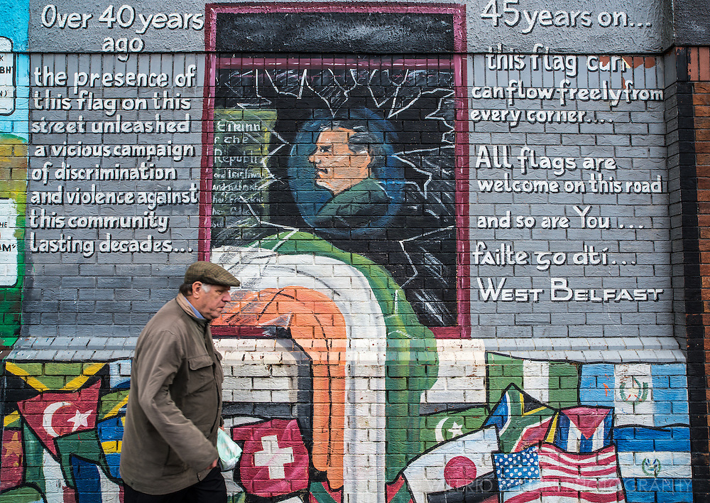 A man passes by a mural celebrating the freedom to wave flags in an area of Belfast where once was forbidden. Murals commemorate, communicate and show display aspects of culture and history. The themes of murals often reflect what is important to a particular community. A mural therefore exists to express an idea or message and could generally be seen as reflecting values held dear to that community.
