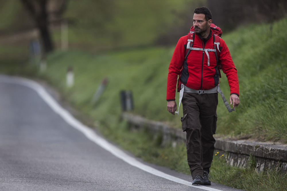 Former Societé Génerale trader Jerome Kerviel , walks in in Tuscany, on March 5 2014.Following a brief meeting with Pope Francis in February, Jerome decided to walk back to France following the footsteps of the ancient Francigena route. Kerviel,  of French securities firm Société Générale  was charged with losing more than $7 billion in company assets by conducting a series of unauthorized and false trades between 2006 and early 2008.Kerviel 's last sentence verdict is fixed for the 19th of march.If the accusation will be confirmed he risks three years in prison for his role in one of the world's biggest trading scandals.