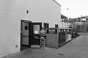 A military guard at the prison camp at Guantanamo, Cuba, Jan 28 2017, guards a door to a prison building.<br /> The guards turn away their faces so you cannot identify them. It is standard operation procedure when pictures are made. When you work as a journalist at the Guantanamo you work under military censorship and all your material is checked every day and approved for publication.<br /> The prison camp on the Guant&aacute;namo naval base was the creation of President George W. Bush. The prison camp was considered an important part of the US war on terrorism. Over the years, 779 people have been brought to the camp. 41 people are still detained. Of them, 26 people count as &quot;forever prisoners&rdquo;, indefinite detainees under the Law of War. Two prisoners have been in the camp since it was opened in January 2002. The last prisoner taken to the camp came in March 2008. The so-called war on Terror and the Guantanamo prison camp have been heavily criticized for violation of human rights regarding torture and habeas corpus.<br /> It is unclear what US President Donald Trump wants to do with the camp, but during the election campaign he said that he would fill Guant&aacute;namo Bay with &quot;bad dudes&quot;. Photo by Ola Torkelsson<br />