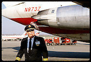 TWA pilot, Captain James Chick, does preflight walk around of MD-80; Lambert Airport/St. Louis Missouri