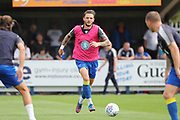 AFC Wimbledon defender Callum Kennedy (23) warming up during the EFL Sky Bet League 1 match between AFC Wimbledon and Doncaster Rovers at the Cherry Red Records Stadium, Kingston, England on 26 August 2017. Photo by Matthew Redman.