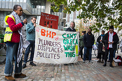 London, UK. 17 October, 2019. Sara Callaway addresses frontline human rights defenders from Chile, Brazil and Colombia and climate justice activists from London Mining Network and War on Want protesting outside the AGM of  British-Australian mining company BHP at the QEII Centre against the company's destructive mining practices, which are contributing to climate breakdown across the globe. There has been an upsurge in death threats and assassination attempts directed at human rights defenders in Latin America opposed to mega-mining in recent months.