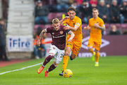 Callumn Morrison (#38) of Heart of Midlothian runs past Shaun Byrne (#6) of Livingston FC during the 4th round of the William Hill Scottish Cup match between Heart of Midlothian and Livingston at Tynecastle Stadium, Edinburgh, Scotland on 20 January 2019.